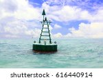 floating red navigational buoy... | Shutterstock . vector #616440914