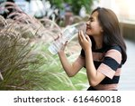 Small photo of fresh up hot day with cool water drink in garden outdoor park in summer