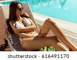 sexy woman in bikini sunbathing ... | Shutterstock . vector #616491170