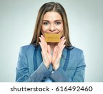 smiling business woman holding... | Shutterstock . vector #616492460