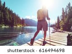 hiking man in canadian... | Shutterstock . vector #616494698