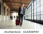 businessman walking in a station | Shutterstock . vector #616506944