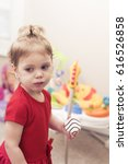 2 year old girl with cookie... | Shutterstock . vector #616526858