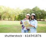 women traveler with backpack... | Shutterstock . vector #616541876
