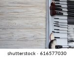 set of cosmetic brushes on a... | Shutterstock . vector #616577030