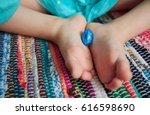 kid with easter chocolate eggs. | Shutterstock . vector #616598690