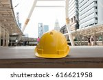 safety hat with city background.... | Shutterstock . vector #616621958