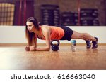 young woman doing plank... | Shutterstock . vector #616663040