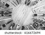 construction tools on a wooden... | Shutterstock . vector #616672694