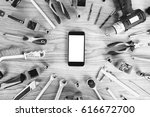 smartphone and construction... | Shutterstock . vector #616672700