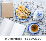 retro style tea set . open book ... | Shutterstock . vector #616693190