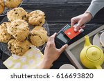 a contactless card payment is... | Shutterstock . vector #616693820