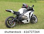 Small photo of Rustenburg, South Africa - March 3, 2017: Parked white Honda CBR1000RR motorbike on green grass at Yearly Mass Ride of Tainted Souls Motorbike Club, Rustenburg, South Africa.