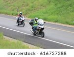 Small photo of Rustenburg, South Africa - March 3, 2017: Speeding motorbikes travelling onto freeway onramp at Yearly Mass Ride of Tainted Souls Motorbike Club, Rustenburg, South Africa.