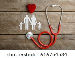 red heart  stethoscope and... | Shutterstock . vector #616754534