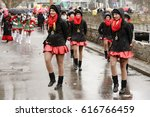Small photo of STUTTGART, GERMANY - FEBRUARY 28: young nice majorettes marching notwithstanding the weather . Shot under rain at Carnival parade in city center on feb 28, 2017 Stuttgart, Germany
