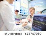 pharmacist handing medication... | Shutterstock . vector #616767050