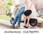 fashionable couple posing on... | Shutterstock . vector #616786994