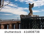 statue of a angel on the fence | Shutterstock . vector #616808738