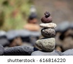 stack of black volcanic stones... | Shutterstock . vector #616816220