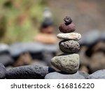 stack of black volcanic stones... | Shutterstock . vector #616816220