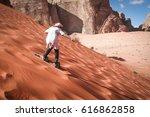 girl sand boarding on dunes in... | Shutterstock . vector #616862858