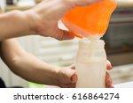 preparing infant formula | Shutterstock . vector #616864274