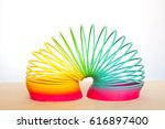 toy plastic rainbow on a white... | Shutterstock . vector #616897400