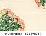 pink orange roses bouquet over...   Shutterstock . vector #616898354