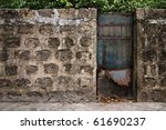 Closed Metal Gate On A Concret...