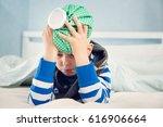 ill boy lying in bed. sad child ... | Shutterstock . vector #616906664