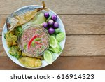 Stock photo fried mackerel with shrimp paste sauce and boiled or deep fried vegetables famous thai spicy food 616914323