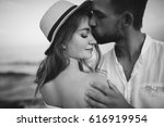 couple in love on the beach | Shutterstock . vector #616919954