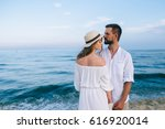 couple in love on the beach | Shutterstock . vector #616920014