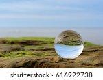 seashore is reflected inside... | Shutterstock . vector #616922738