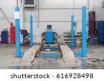 workshop bay of wheel alignment ... | Shutterstock . vector #616928498