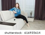 young woman in black pants and... | Shutterstock . vector #616935614