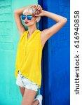 beautiful young woman walking... | Shutterstock . vector #616940858
