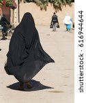 a woman in a burka burqa...   Shutterstock . vector #616944644