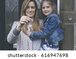 mum and daughter showing of the ... | Shutterstock . vector #616947698