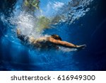 underwater shot of the young... | Shutterstock . vector #616949300