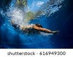 underwater shot of the young... | Shutterstock . vector #616949300