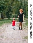 mom and little daughter walking ... | Shutterstock . vector #617021870