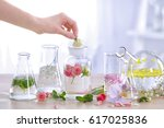 woman mixing perfume samples on ... | Shutterstock . vector #617025836