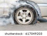 burst tire on the road | Shutterstock . vector #617049203