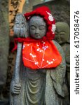 Small photo of Japanese statues with red hoods named Jizo Bosatsu, Ksitigarbha or Ojizo sama are protectors of children, especially those who died before their parents as well as miscarriages and stillborn.