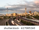 cars rushing along the... | Shutterstock . vector #617085260