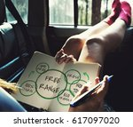 girl in the car studying free... | Shutterstock . vector #617097020