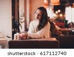 stylish girl 24 29 year old... | Shutterstock . vector #617112740