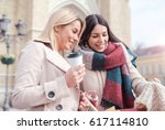 shopping time. two attractive... | Shutterstock . vector #617114810